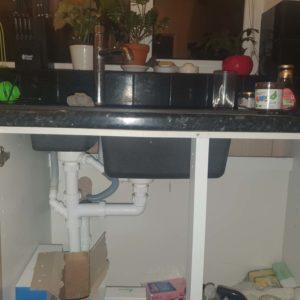 exposed plumbing underneath sink